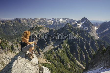 hiker looking at view while sitting