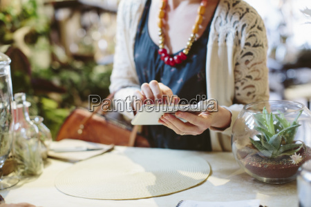 midsection of customer making card payment