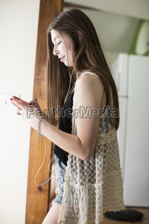 side view of teenage girl using