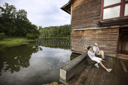 senior couple sitting on chairs by