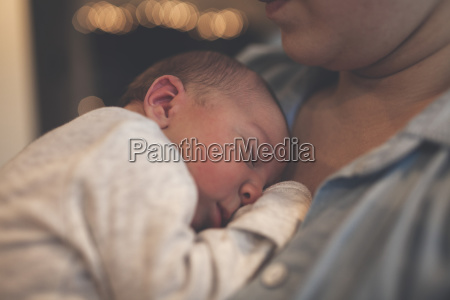 cropped image of mother holding newborn