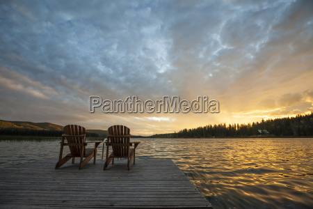 chairs on pier by lac le