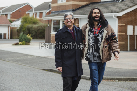 happy father and son walking home
