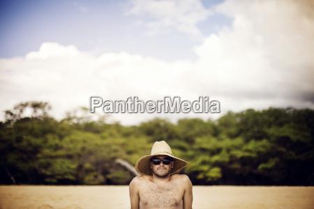 portrait of man wearing straw hat