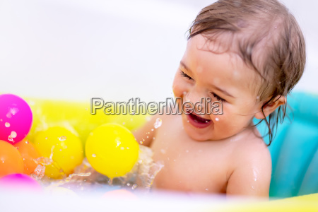 excited boy in the bath