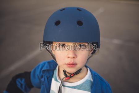 portrait of cute boy wearing helmet