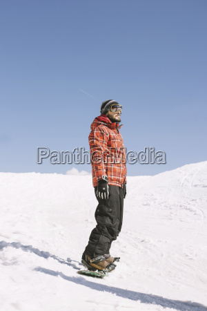 man looking away while standing on