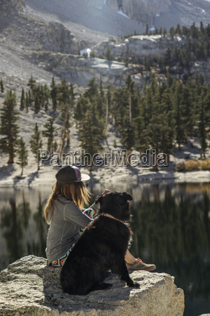 side view of woman with dog