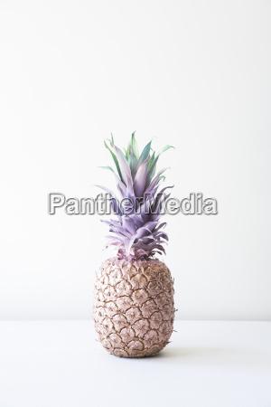 painted pineapple on table against white