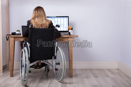 disabled businesswoman working on computer