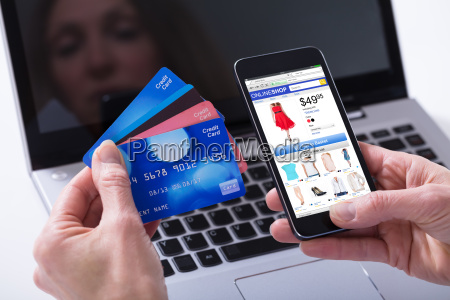 woman shopping online with credit cards