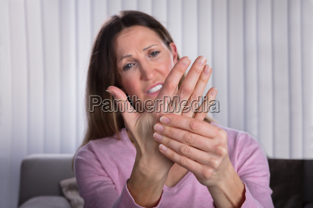 upset woman suffering from palm pain
