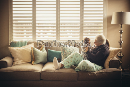 grandmother playing with baby grandson on