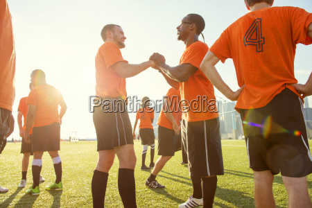 happy soccer team on field during