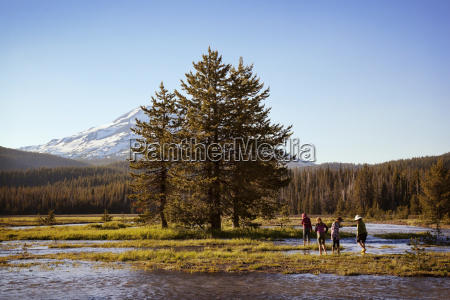 people, enjoying, in, lake, by, trees - 25042628