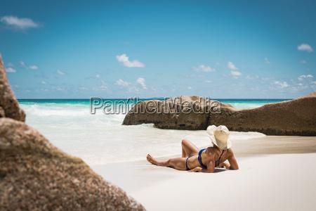 mid adult woman in bikini relaxing