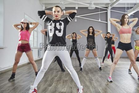 full length of female dancers practicing