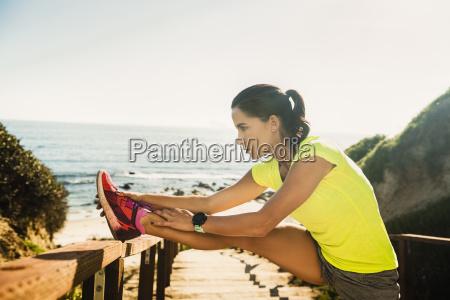 usa california newport beach woman stretching