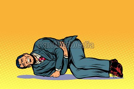 man lies hurts stomach