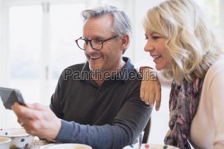 mature couple taking selfie with smart