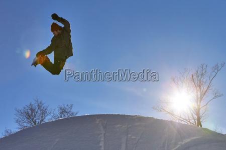 snowboarder performing method air grab trick