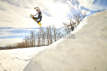 snowboarder doing switch method trick in