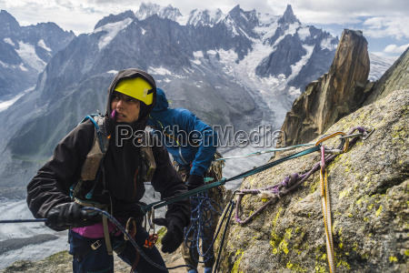 rock climbers rappelling in french alps
