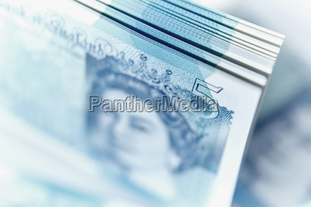 close up five pound note stack