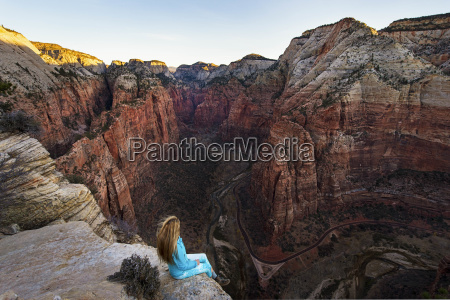 woman looking at view of canyon