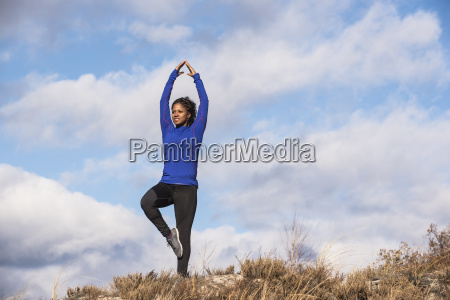 woman practicing yoga outdoors newburyport massachusetts
