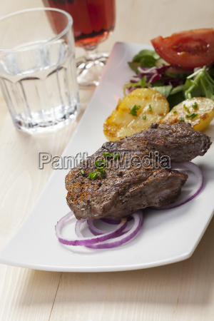 steak with potatoes and salad