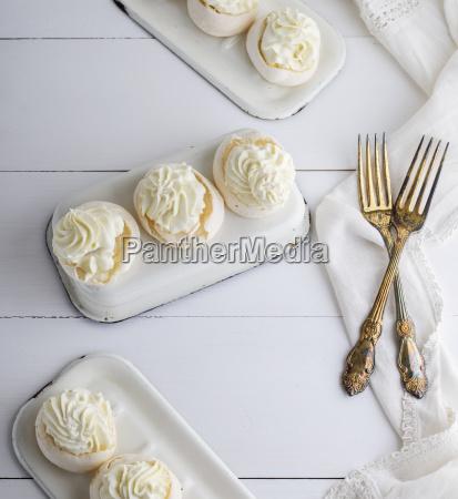 baked round meringue with cream on