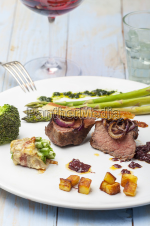 grilled steak with asparagus on a