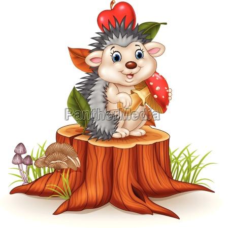 little hedgehog holding mushroom on tree