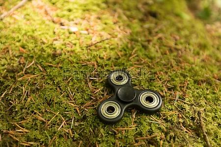 fidget spinner laying on grass