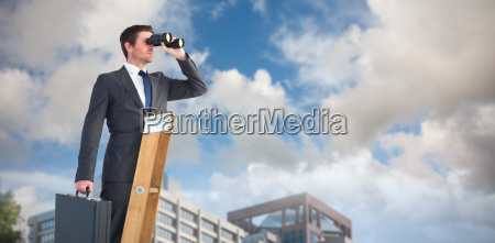 composite image of businessman looking on