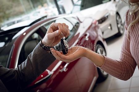 close up of salesman giving car