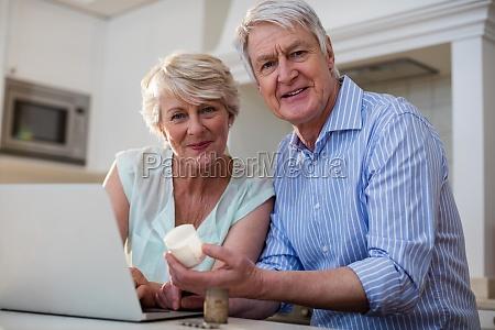 portrait of senior couple checking medicine