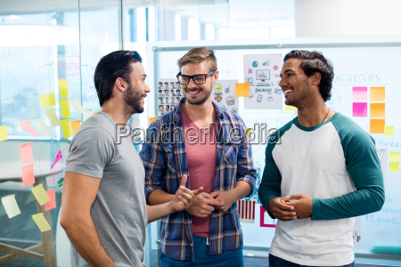 creative business team discussing against the