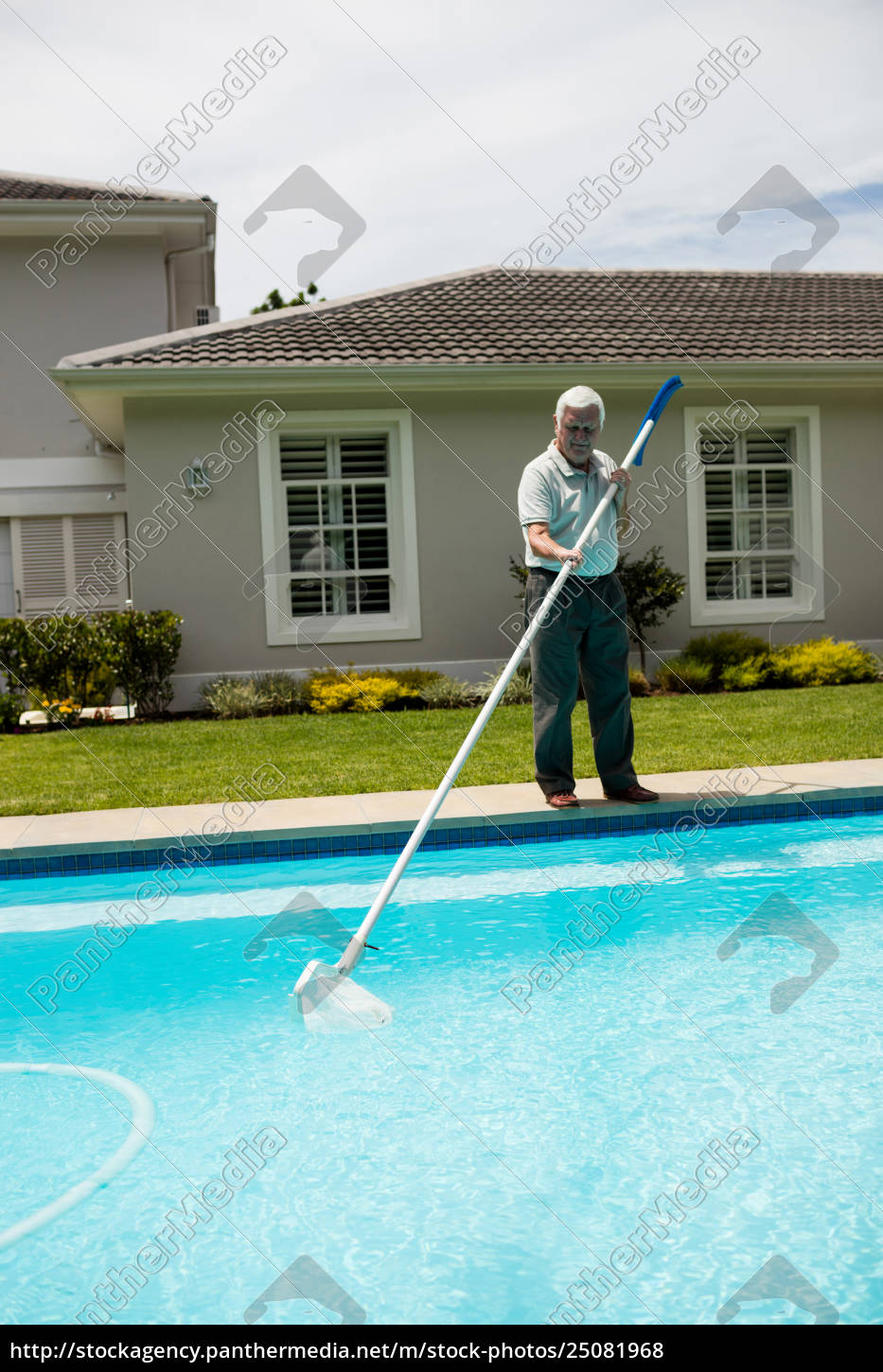 Royalty free photo 25081968 - Senior man cleaning swimming pool