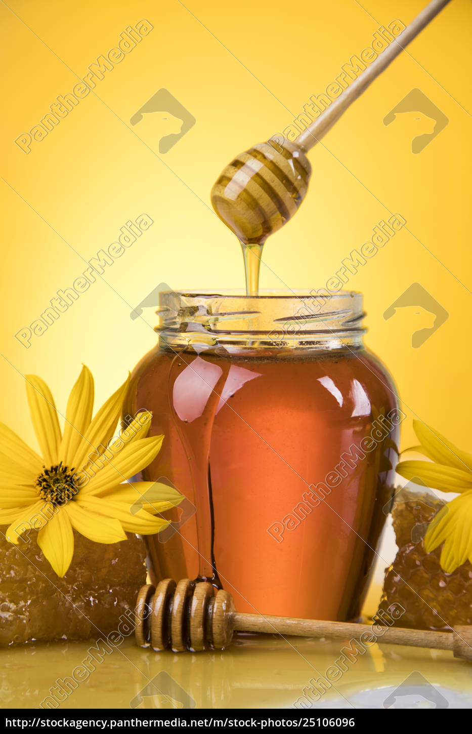 honey, and, wooden, stick, are, on - 25106096