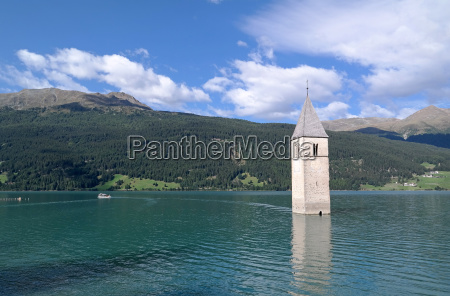 lake reschen with church on the