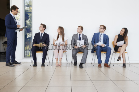 recruiter and people waiting for job