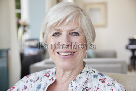 happy senior woman smiling to camera