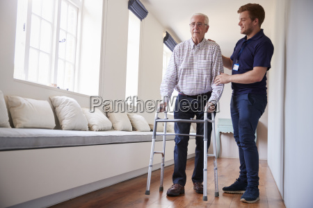 senior man using a walking frame