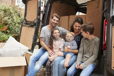 family sitting in back of removal