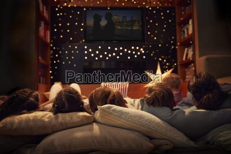 family enjoying movie night at home
