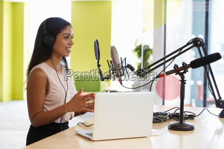 young mixed race woman recording a
