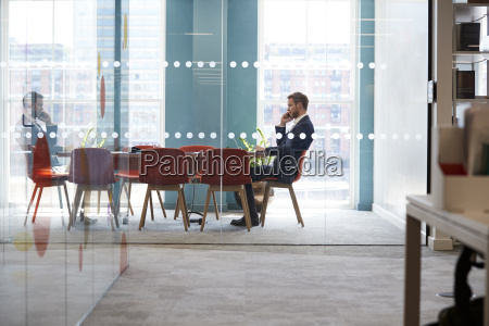 young businessman using phone in an