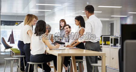 business group brainstorming in open plan